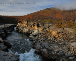 Part of the Abisko National Park with the canyon and adjacent low hills adorned birch decorated breath of autumn.