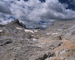 Contrast of desert rock and sky on the crest of the Julian Alps