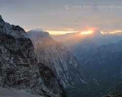 Last beam comming through the gap over the peaks of Julian Alps