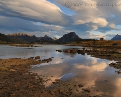 Clouds gallop across the sky and morning moonlight painted on shallow fjord levels fantastic images.
