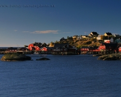 Fishing village on the furthest corner of the Lofoten with typical color contrast of cottages and ocean