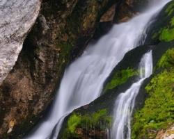 One of the many breathtaking waterfalls berúcich Julian Alps
